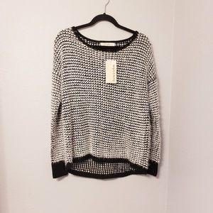 Rewind black and white eyelash sweater. Size med
